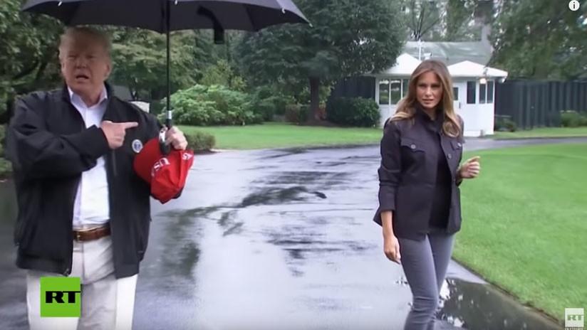 Trump no presta paraguas y deja a Melania mojarse